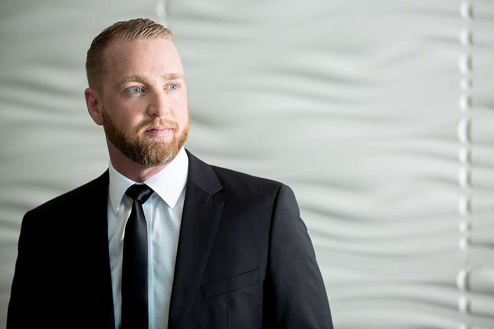 Peter Strack in a black suit and tie